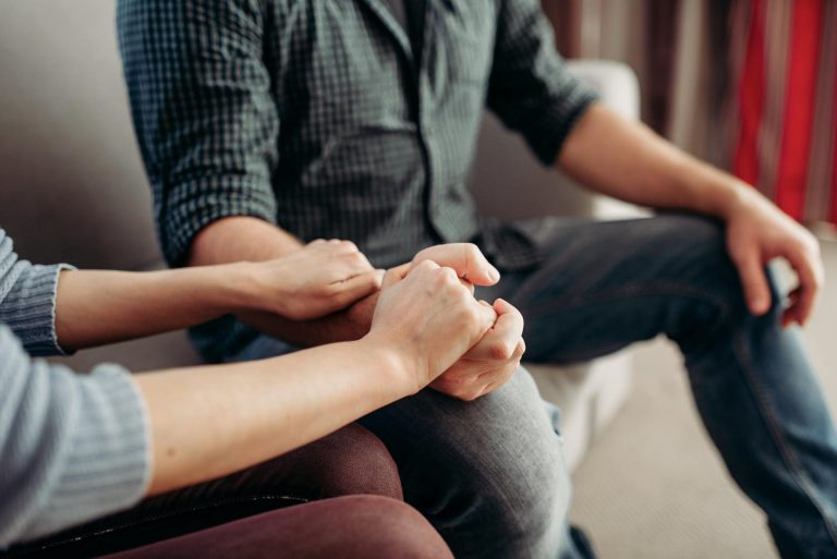Couple hold hands, family psychology support