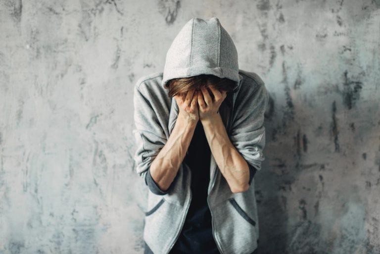Druggy sitting on the floor, withdrawal symptom