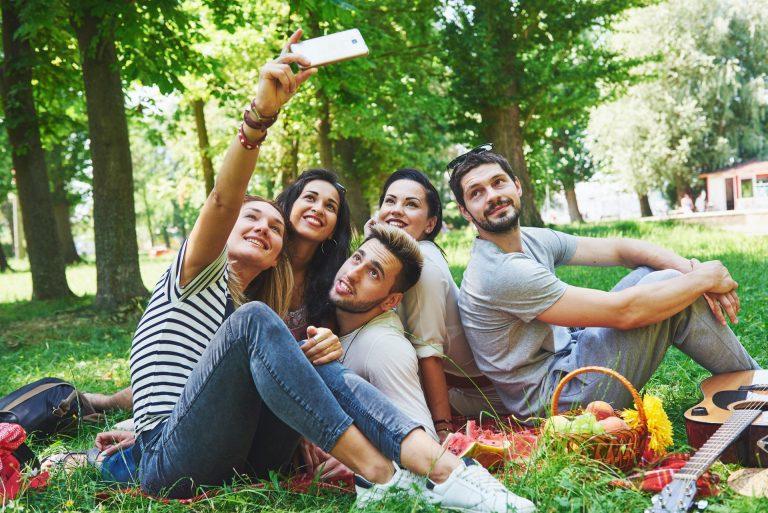 Happy friends having fun outside in nature