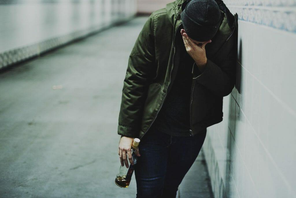 Man Holding Liquor Bottle Feeling Depressed