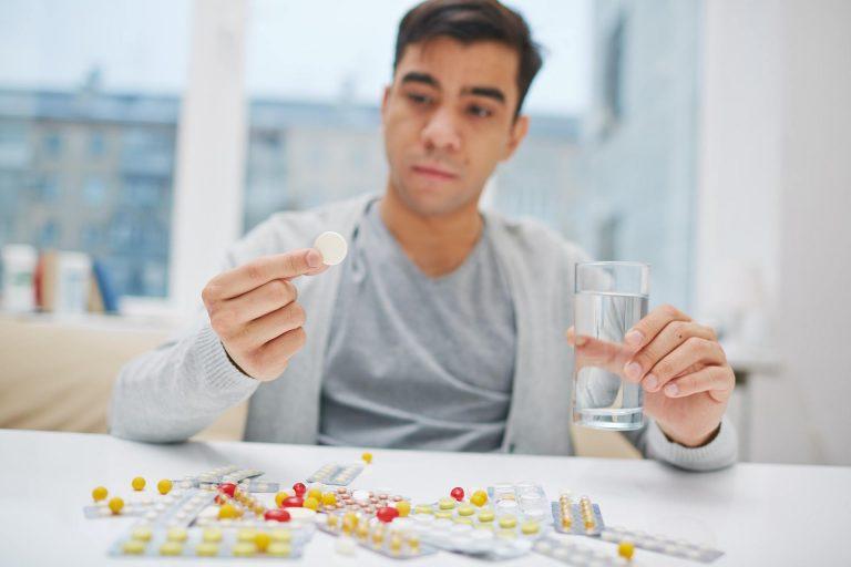 Man taking medications