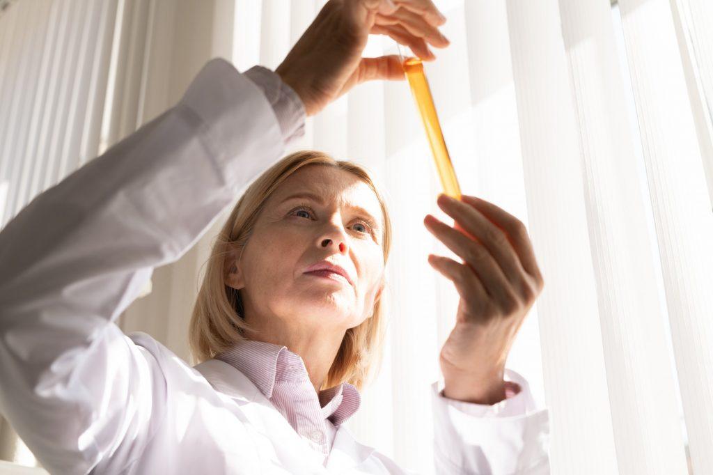 Pensive medical scientist working on drug