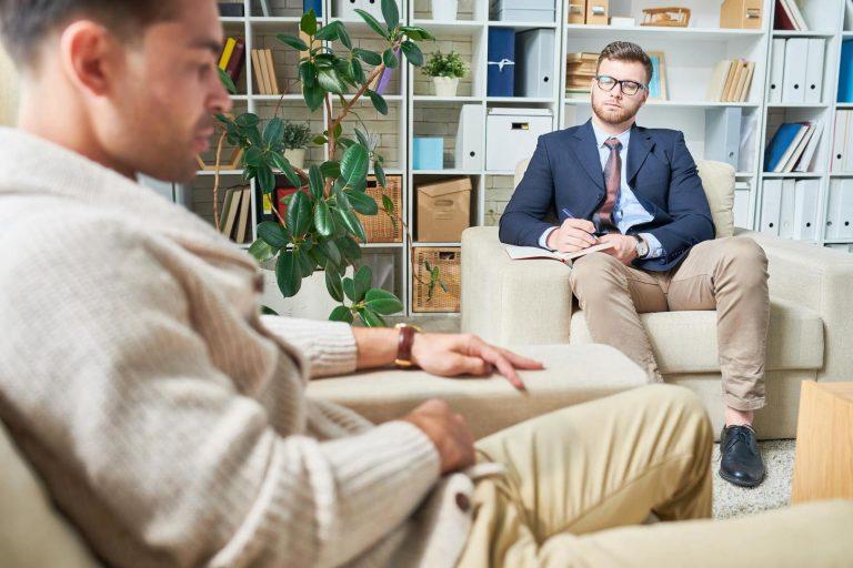 Psychiatrist Listening to Patient